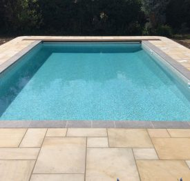 Thermally efficient polyblock pool with extreme onsite liner