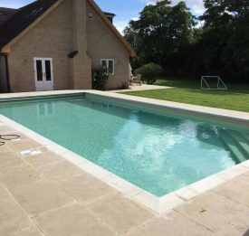 Beautiful outdoor pool with disappearing leading edge safety cover