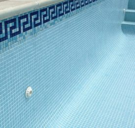 New tile band on outdoor pool