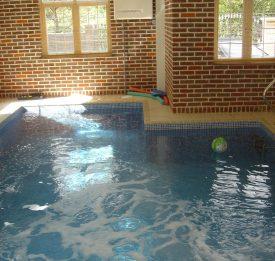 New build small residential pool with built in spa wall