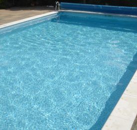 Outdoor pool with reel cover