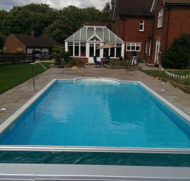 Domestic liner pool with safety cover and fountain