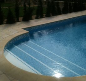 Domestic tiled pool with roman end