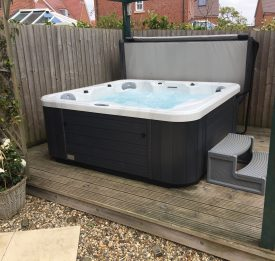 Elegant hot tub on decking