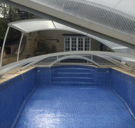Amazing pool enclosure with beautiful custom liner