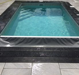 Elegant new build pool with Aquaguard grey disappearing leading edge
