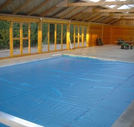 Indoor pool with wooden enclosure