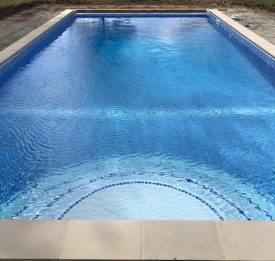 Pool renovation with new build steps and coping