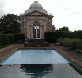 Outdoor pool with slatted cover