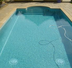 Outdoor residential pool with roman end