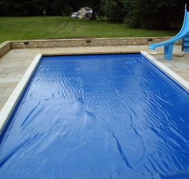 Safety cover on pool with slide