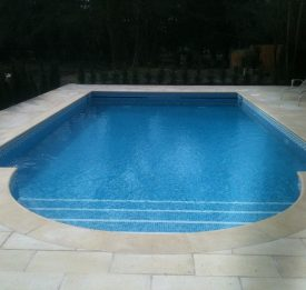 Complete new build tiled pool with Maldives tiles and Haddon stone copings