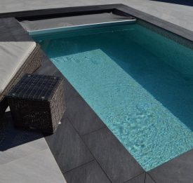 Small pool with grey safety cover