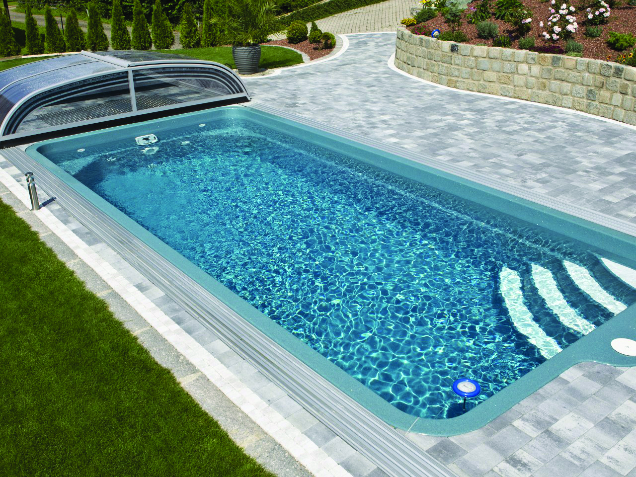 Small pool with glass enclosure
